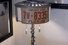License plate lamp with vintage spark plug pulls.