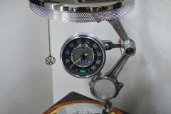 VW themed lamp. 12V automotive style LED's. Interior of speedometer is lit. Sapele and maple base, all vintage parts. This lamp took first prize at the 2019 Orange County Fair in the upcycled category.