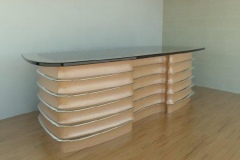 Art Deco themed ribbed desk. Wood, stainless and glass materials.