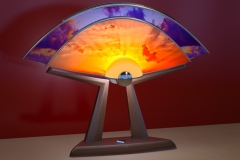 Sun-lamp, concept shown as if light projectors on 2 screens displayed live video image feeds of sun and moon.