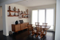Shelves on wall built for neighbor to match his George Nakashima dining room set.
