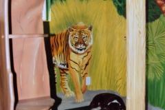 Detail of mural in jungle room.