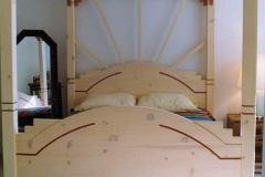 Art Deco/southwest themed bed for my wife, made before we were married. Solid pine.