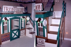 Train station theme clubhouse bed, for same customer as gas station. Working lights and clock.