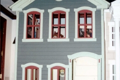 All molding details handmade, with custom turned columns. Scaled down siding.