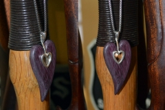 Modeled the center section in 3ds Max and had printed in silver, wood heart is purpleheart. Natural color.