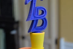 Winestopper with friend's initials. 3D print in plastic.