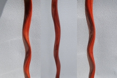 Serpentine cane in stained mahogany.